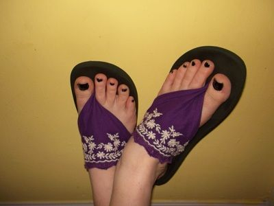 This is a nifty little trick......flip flops that break.....replace with a scarf or fabric. We all have those flip flops that break between the toe. :( (Usually when you are somewhere you don't really need them to break. ) :(
