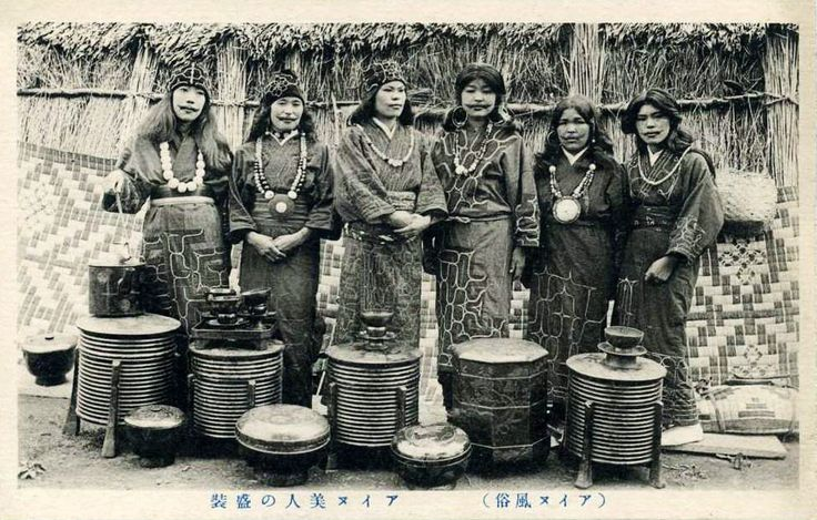 Ainu women with storage vessels