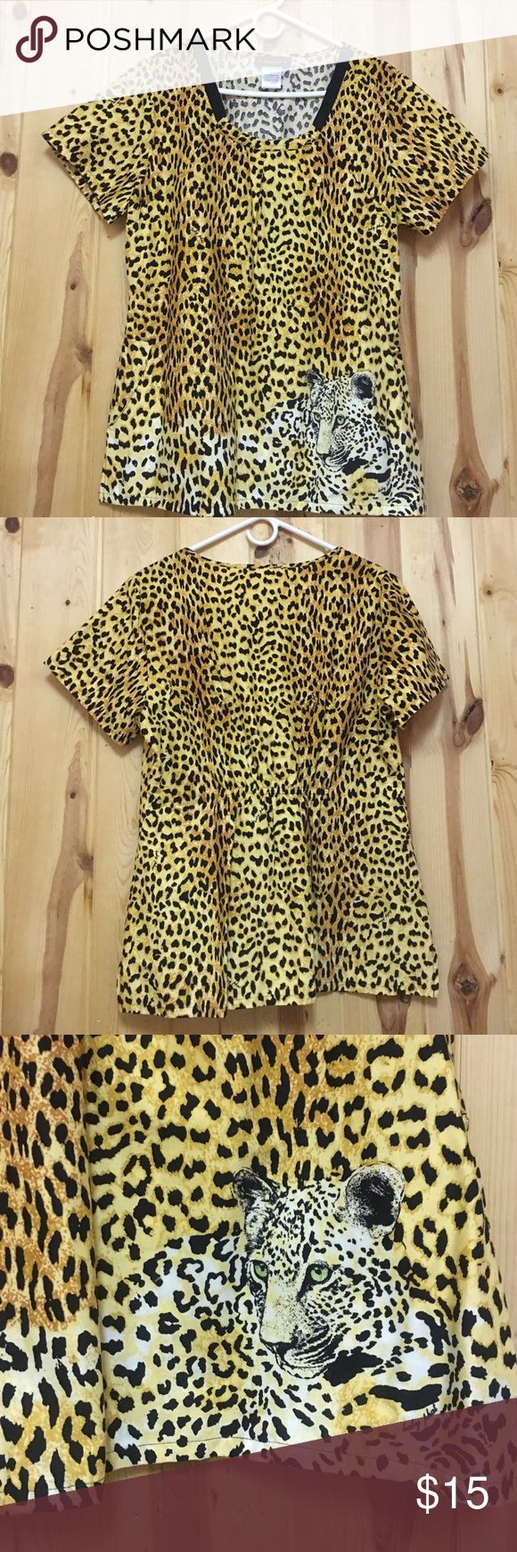 Baby Phat Scrub Top Large NWOT Baby Phat Scrub Top has two Side Pockets and Elastic in the back Print of Tiger on front left Baby Phat Tops