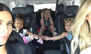 http://www.dailymail.co.uk/tvshowbiz/article-3246023/Close-bond-Kim-Kardashian-posts-sweet-snap-North-West-Penelope-Disick-holding-hands-family-road-trip.html