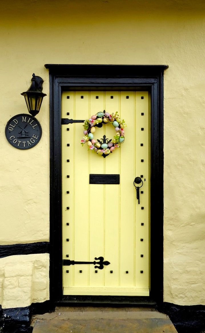 Yellow door to OLD MILL COTTAGE in Finchingfield, Essex, England.
