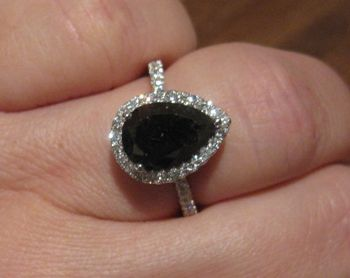LD's 4.1 carat pear shaped black diamond is set in a white diamond halo ring. Natural black diamonds are essentially colored by dark inclusions or impurities, which are great in number and evenly distributed throughout the stone. Many black diamonds in the marketplace are irradiated for even coloration. One of the most remarkable natural black diamonds is the 67.50 carat Black Orlov.    Read more: http://www.pricescope.com/blog/april-birthstone-diamonds-pricescopers-best-friend#ixzz27veRCL5e