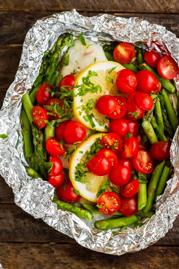 Here are FOUR simple ways to make Baked Tilapia in Foil! Toss 'em on the grill or in the oven - but NEVER have dishes to clean!