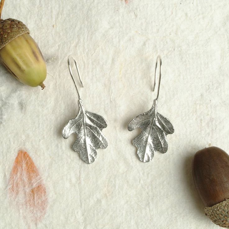 Beautifully detailed Oak leaf drop earrings These oak leaf earrings are polished lead free pewter with sterling silver wire. Handmade in the UK by Glover and Smith. Delicate, beautifully simple and easy to wear. They make a great gift for that special someone. The perfect tenth anniversary gift (pewter is 92% tin). The oak tree symbolises hospitality, stability, strength, honour, eternity, endurance and liberty.Lead free pewter leaves with Sterling silver wire. All Glover and Smith designs…
