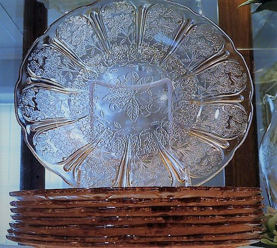 ITEM #RA-77  Listing is for set of eight 1930s Art Deco pink depression glass Cherry Blossom 9 dinner plates produced by the Jeannette Glass Co.  Plates measure 9 in diameter. Due to the weight, these plates will be professionally wrapped, tracked and insured through UPS.  Condition: ALL are in very good antique-vintage condition with typical wear due to age and handling. No chips, cracks, scuffs, etc. One plate has a black speck. It appears to have happened during the production process…