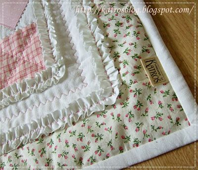 Tons of quilting ideas here - in another language, but I like the idea of adding a ruffle as a border between sections and the quilting on the white
