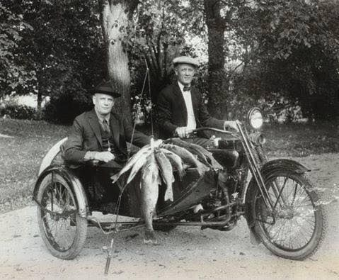 After a day of fishing, William Harley and William Davidson ( Brother of Arthur ) taking home their catch in 1924 .