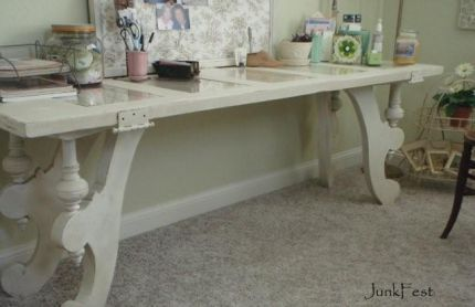 Door turned desk..or it could be a sofa table. Love the decorative table supports.....