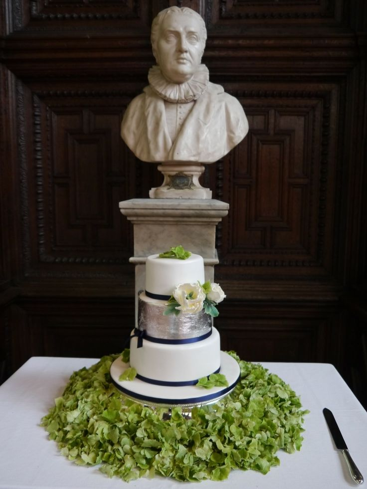 The wedding cake surrounded by flowers