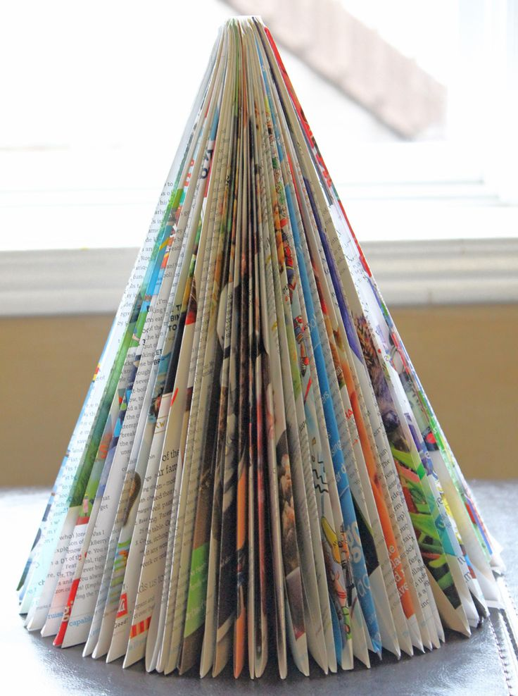 Magazine Christmas Trees - I'm about to recycle a bunch of magazines - unless someone wants to claim some for this (or other magazine-related crafts). @Rachael Hummel @Ashlee Ryan