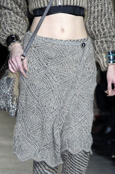 Really? A crop top in the winter? Why wear all of this wool and cool-weather clothing if you're going to have your core exposed? Dumbassed Missoni Fall 2010. That having been said, I'd rock the hell outta that knitted shawl worn as a wrap skirt. - Details