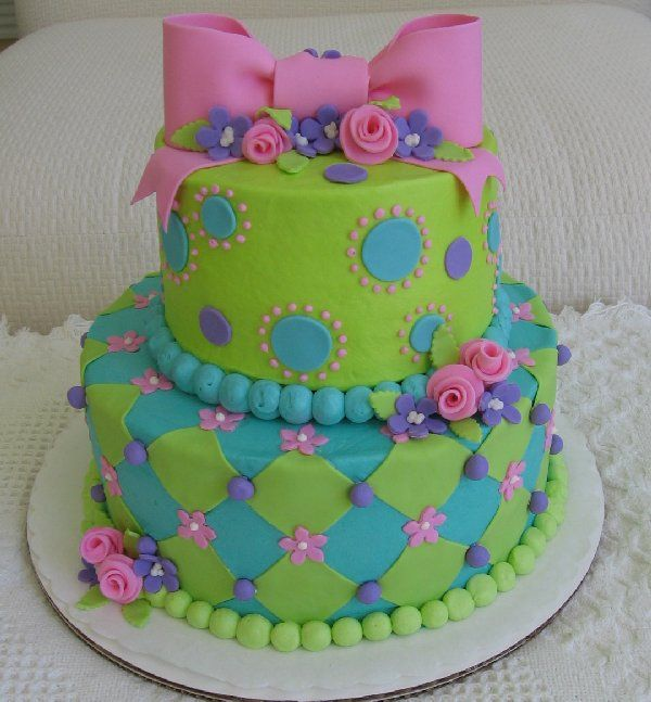 """Turquoise, Lime Green and Pink Cake - 9"""", 6"""" rounds covered in buttercream with fondant decorations.  Colors to match a 13 year old's birthday party."""