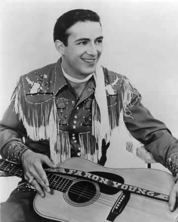 "Faron Young (1/25/1932 - 12/10/1996)     American country music singer and songwriter 950s - mid-1980s. Hits including ""If You Ain't Lovin' (You Ain't Livin')"" and ""Live Fast, Love Hard, Die Young"" marked him as a honky-tonk singer in sound and personal style; and his chart-topping singles ""Hello Walls"" and ""It's Four in the Morning"" showed his versatility as a vocalist.  Hillbilly Heartthrob, Young's singles charted for more than 30 years. Young is a member of the Country Music Hall of…"