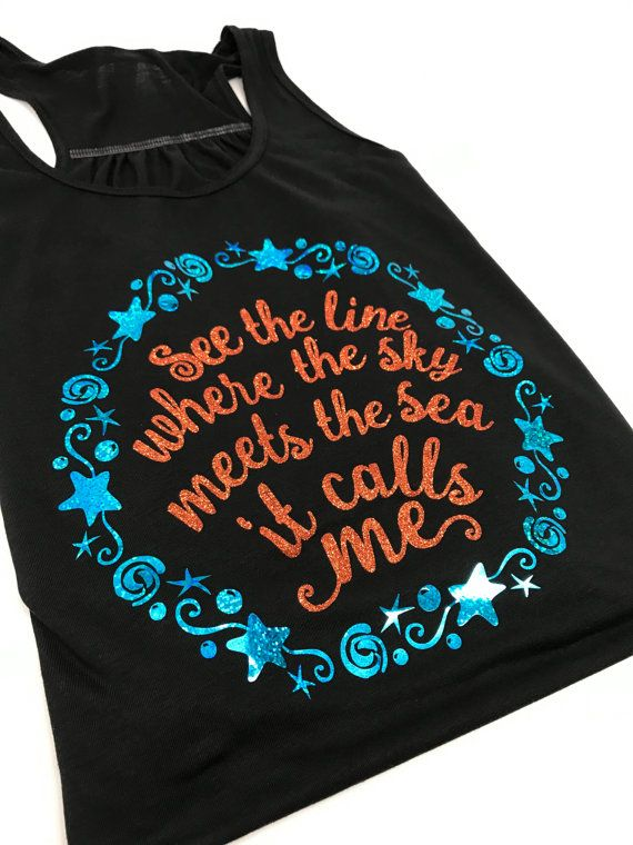 Get inspired to explore with our exclusive See The Line Where The Sky Meets The Sea It Calls Me shirt! This design comes on a black shirt with our non-flake glitter orange and aqua blue holographic. *************************************************************** To complete your outfit, visit our shop for more one of a kind handmade pieces. We are proud to be a one stop shop featuring coordinating shirts, tutus, necklaces and hair accessories, making it easier for you to put together that…