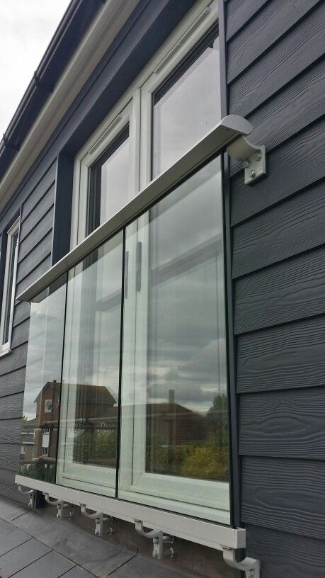 Glass Juliet balcony.  French doors and cedral cladding.