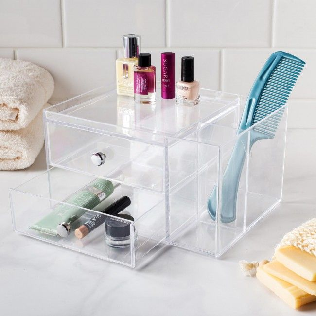 Organize your bathroom countertop or makeup table with an Interdesign Clarity Stacking 2-Drawer with Organizer. The clear plastic organizer lets you see what is inside while keeping everything neat and tidy.