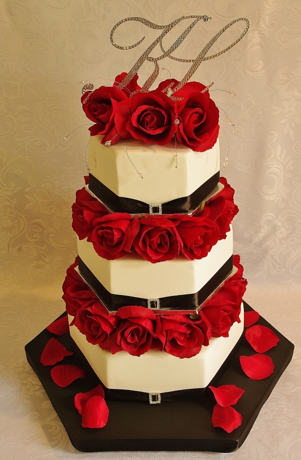 Hexagon shaped cake with red roses & Swarovski crystal monogram on top :)