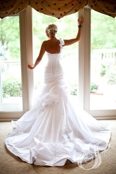 Beautiful wedding dress. One shoulder, corset back . Love the pose and pic!