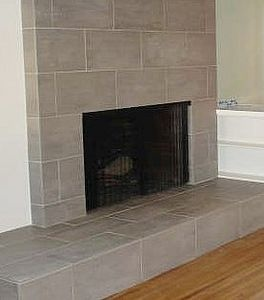 How to tile over a brick fireplace to be the used and mantles - Tile over brick fireplace ...