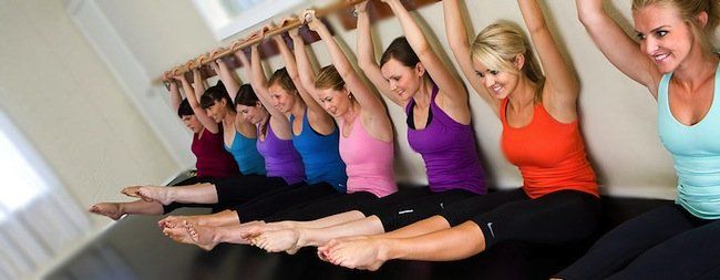 women at a pilates barre class