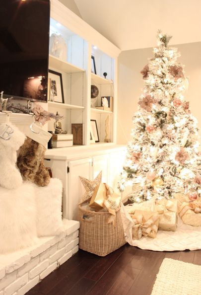 I love the brightness of this living room. I love the placement of the beautiful white tree. Picture perfect!