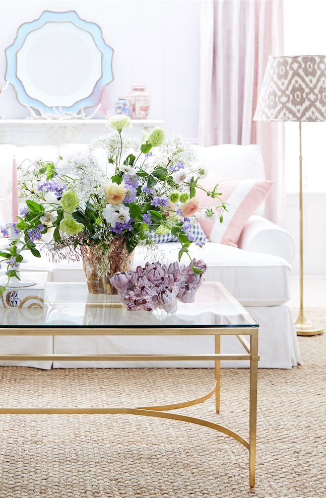 Pastel blue, baby pink, the palest lavender and touches of gleaming gold make for an ultra-feminine living room style.