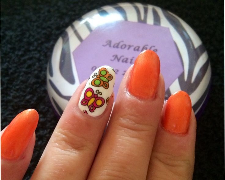 Cnd electric orange shellac with butterfly foil