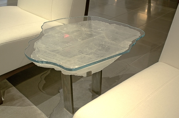 Quartz tables by Brenda Houston at Holly Hunt. The stunning agate and quartz slabs were attached to a custom bronze base and glass top which was each laser cut to match the shape of the stone. Each table is very unique, and utterly gorgeous. #furniture #table