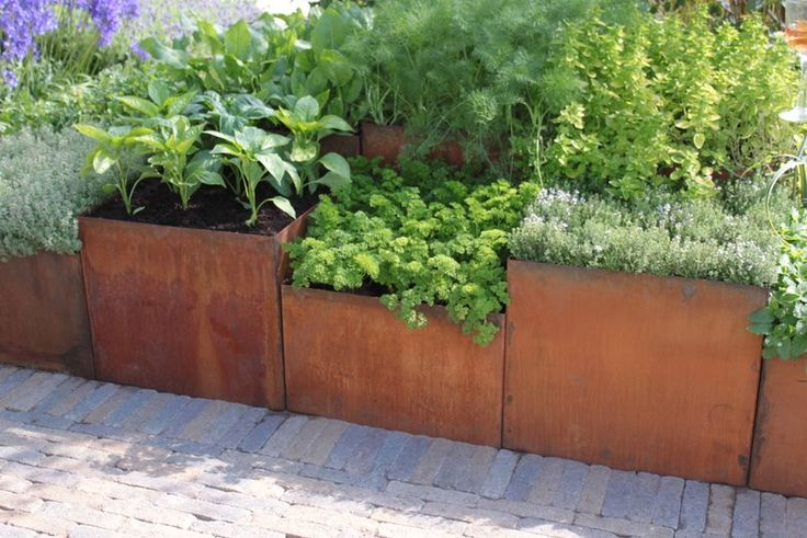 Line your planters with newspaper before you add soil. It helps retain water and keep the soil temperature more constant, keeping the plants healthier and saving water. (And watering time!)