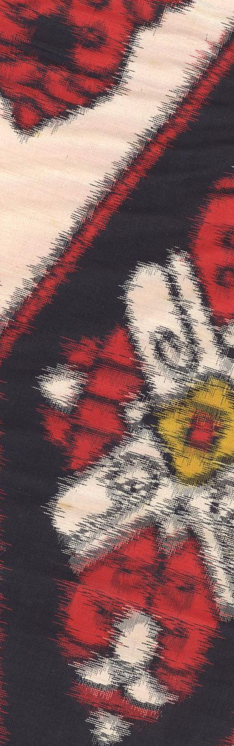 Detail of a bold silk meisen, (ikat) kimono featuring interlocking diamonds of contrasting flower motifs.  Early Showa era (1930-1950).  The Kimono Gallery