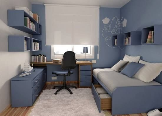 Cama com gavetas e mesa com gaveteiro e armário auxiliar com prateleiras em cima.