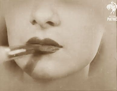 """1930s lip makeup  With thin lips – where is that cat? The middle V must be 'enlarged' to shorten the space under the nose, and the ends left severely alone again."""" Voila !"""