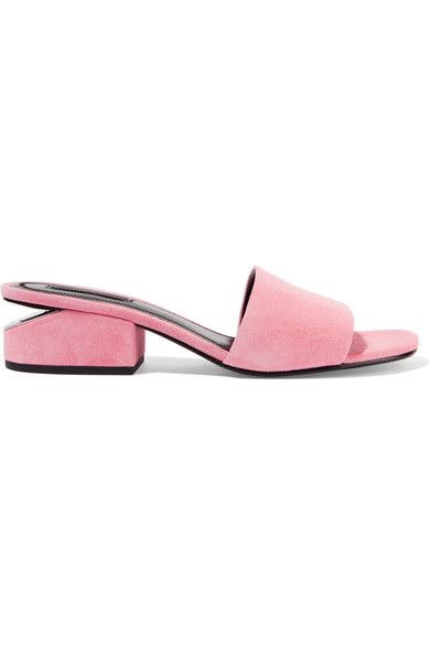 Alexander Wang's 'Lou' mules feature the brand's signature cutout heel that's plated with silver hardware. This pair is made from supple suede in a pretty baby-pink shade. Make them pop against blue denim.