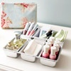 In the Pan  Eliminate vanity clutter by storing beauty essentials in mini loaf plans. Use each compartment to organize a single type of product such as makeup sponges, nail polish, perfume, and brushes. Loaf pans come in many sizes and their stainless-steel finish makes them sleek enough to sit out on a countertop.