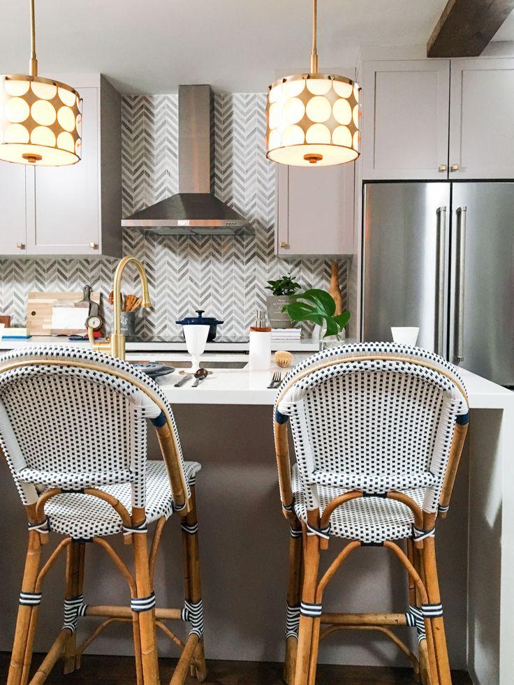 chevron backsplash, drum pendants, cane chairs, kitchen design