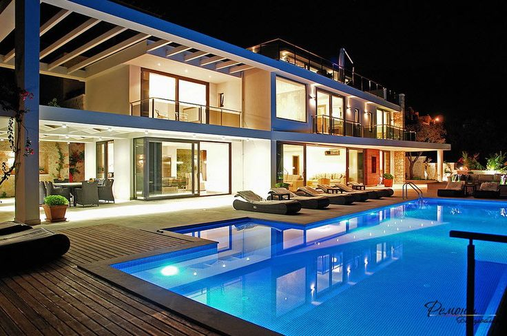 home swimming pools at night. A Bright Villa At Night With View Towards The Swimming Pool Wooden Deck And Comfort Home Pools N