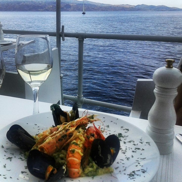"""Omilos is one of the most famous restaurants in Greece, visited by international celebrities. It offers amazing view, tasteful dishes and nice cocktails. Our special tip? Don't miss """"beef fillet with Mavrodafni wine"""".  Learn more: http://sail-la-vie.com/discover/l/3474/Omilos_Bar-Restaurant_-_Hydra"""
