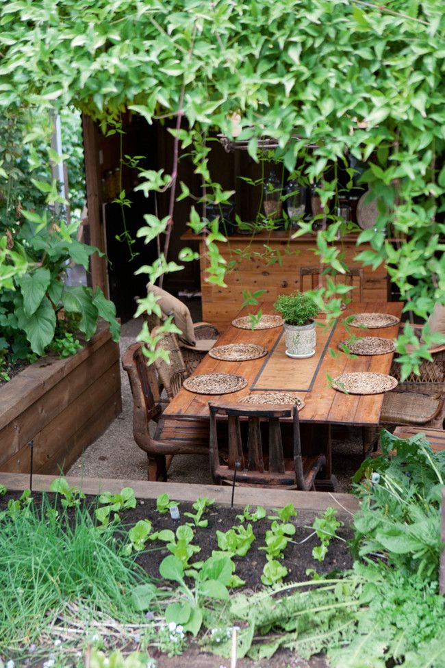 love these raised beds surrounding the outdoor dining area.
