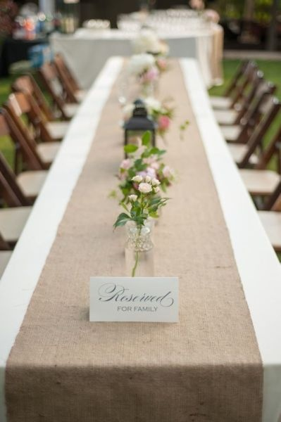 Long Tables, Wildflowers, & an adorable Lantern in the Center. Simple and affordable <3