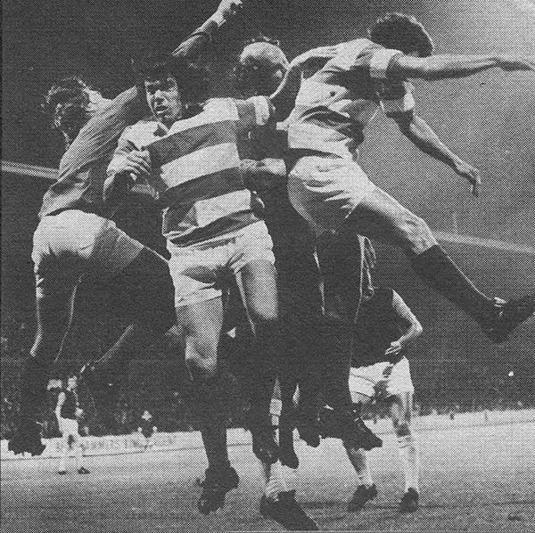 4th September 1973. Queens Park Rangers goalkeeper Phil Parkes and defenders Tony Hazell, Terry Mancini and Ian Gillard get themselves in a panic when clearing against West Ham United, at Loftus Road.
