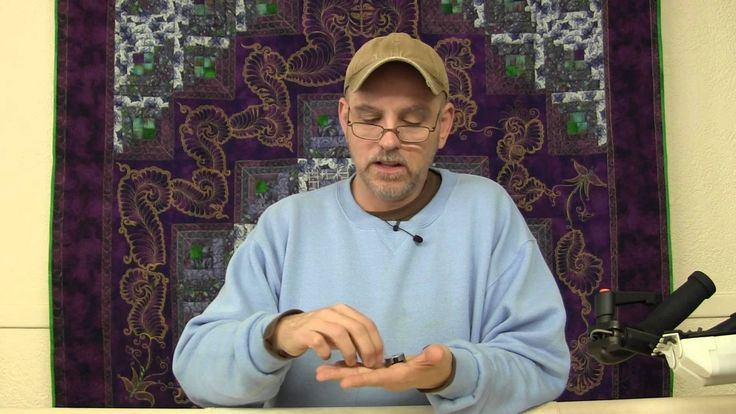 Taking the stress out of Longarm tension. This man is an angel. An ANGEL I tell you!!! Plus, getting to admire that gold threadwork on the purple wall quilt in the background is a huge bonus to the plethora of information he has to share.