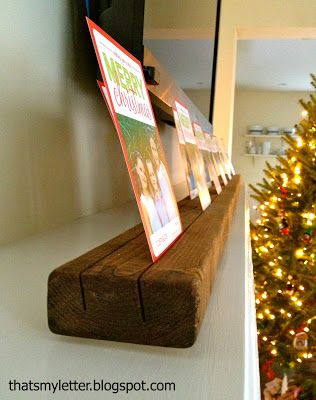 DIY xmas card holder- 2x4 cut with circular saw at a slight angle.  Stain and done.  (No poly as that would fill in cuts!)