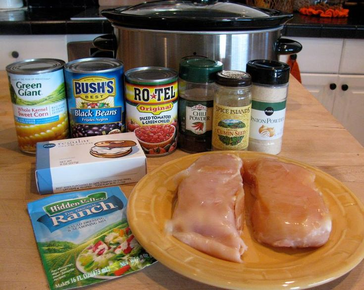 2 chicken breasts, still frozen  1 can Rotel tomatoes  1 can corn kernels, do not drain  1 can black beans, drained and rinsed  1 pkg. Ranch dressing mix  1 T cumin  1 t chili powder  1 t onion powder  1 8-oz pkg. cream cheese    _________      Put