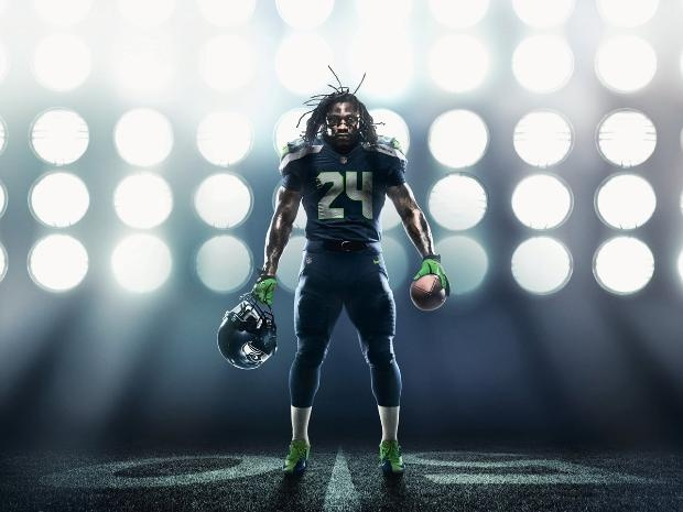 Marshawn Lynch in the new Seahawks uniform, which features a nod to the 12th man by way of a #12 patch on the inside collar, and twelve feathers on the outside of the collar and down the side of the leg, as per the Seahawks' request.  This is the first NFL uniform to acknowledge the fan. I think that's pretty friggin' cool of the Seahawks.