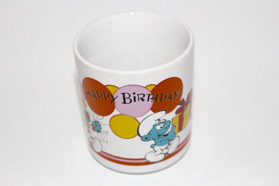 Wow! Remember the Smufs? This is a great collectible Smurf Happy Birthday from 1981. You certainly will enjoy drinking your morning coffee from this vintage mug. Have fun!  Vintage Condition: Great condition with no cracks or chips, but has scratches inside the cup. Made in: Korea  Approximate year of manufacture: 1981  Manufacturers stamp: Wallace Berry & Co. Inc; 1981; #7514; Made in Korea  Size: Approx 3.5 Tall and 3 in diameter  Thank you
