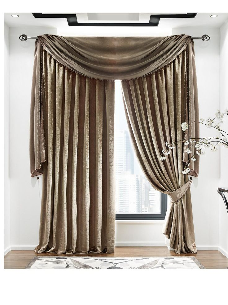 Laurence Llewlyn-Bowen Venezia Pleated Curtains in 3 widths, 3 drops and 4 coloursDesigned by the master of modern décor, Laurence Llewelyn-Bowen, these stunning curtains are perfect for turning your windows into a flamboyant feature.In 4 fabulous colours – noir, posh gold, purple and mink – the velvet-effect finish of each one gives them a wonderful shimmer and depth that simply exudes luxury.Topped with a pleated header, they're versatile enough to be hung from a curtain track or…