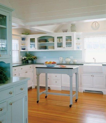 "Pretty ""seaglass"" kitchen with 1940s inspiration, mismatched storage, and cute rolling island."