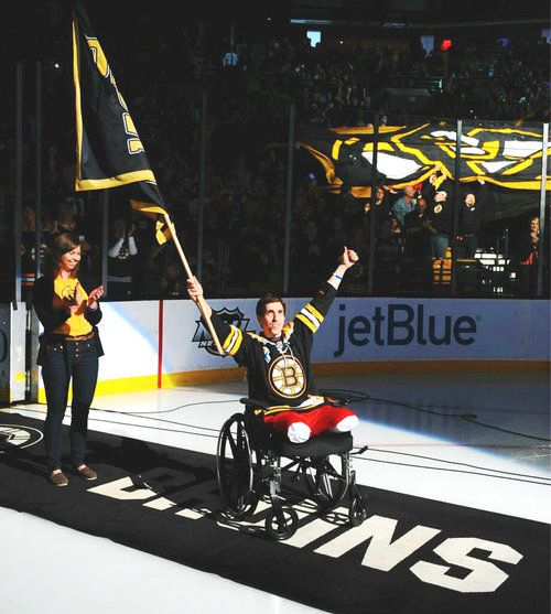 Jeff Bauman, who lost both of his legs in the Boston Marathon tragedy, pumps up the Garden crowd just before puck drop. May 4, 2013