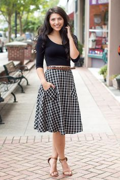 Black and white checkered skirt with neutral accents...
