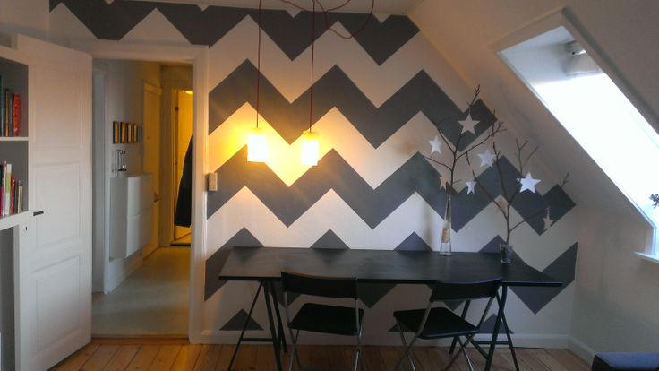 The big difference made by hand painted chevron patterned wall art - our living room.